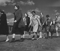 Women arriving at camp