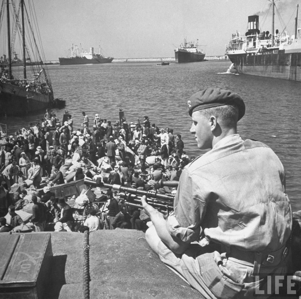 British soldier sitting guard on a rooftop Haifa_Dmitri Kessel_LIFE 1948