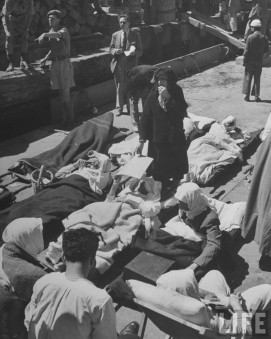 Injured Palestinians lying on cots waiting to be evacuated in Haifa_LIFE 1948