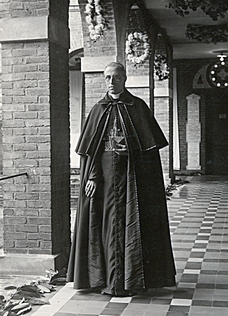 Pacelli in Lisieux posing in the cloister