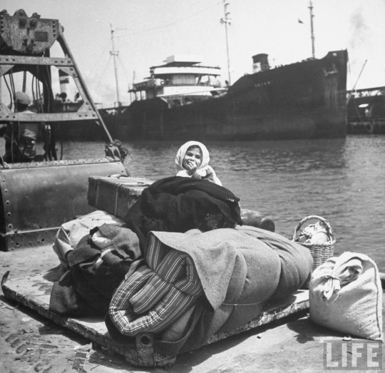 Palestinian child refugee waiting on the dock to leave Haifa